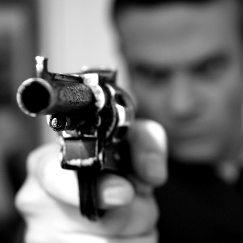 close up of man pointing gun Playing Dea
