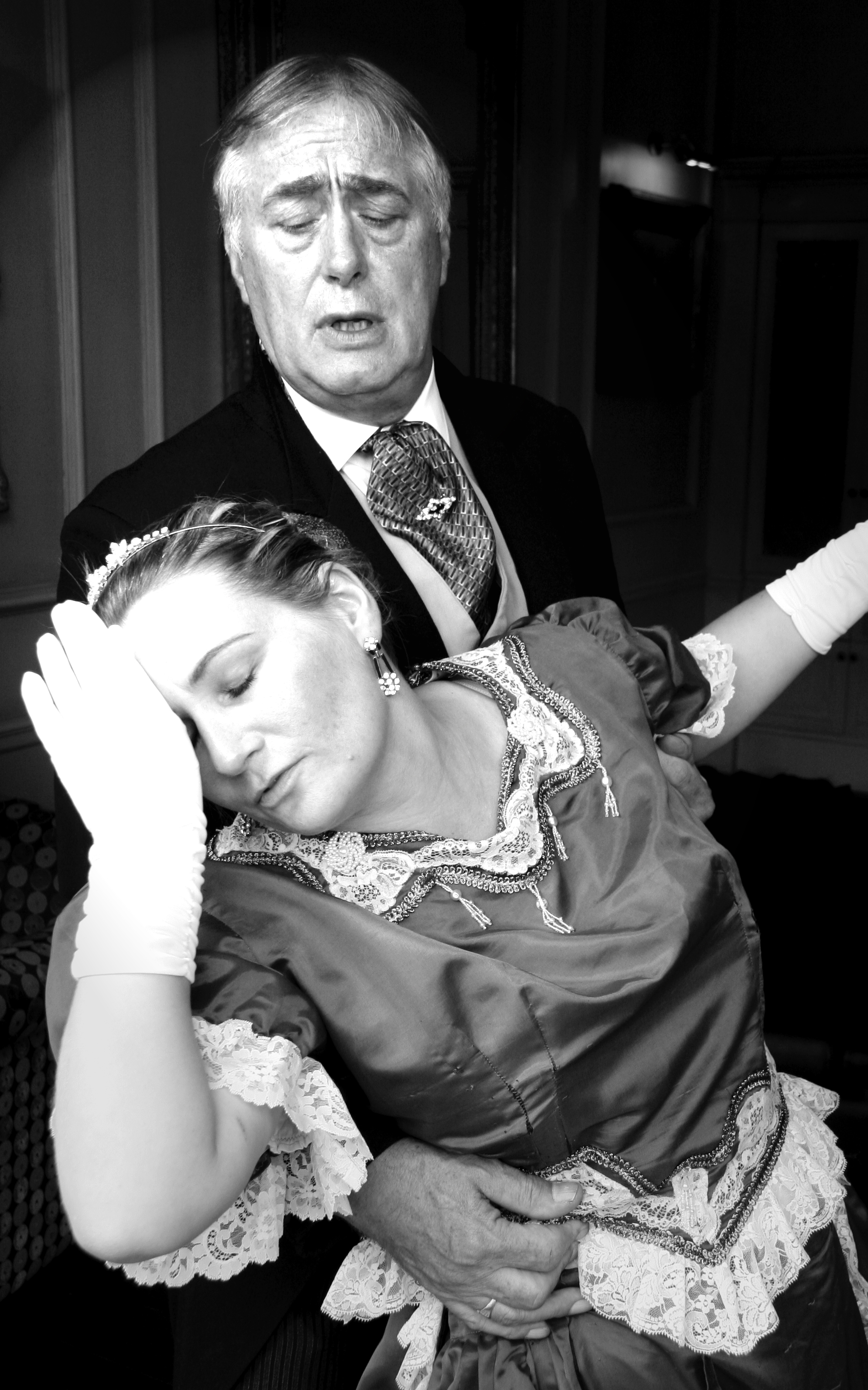 Woman faints in mans arms Playing Dead Murder Mystery.jpg