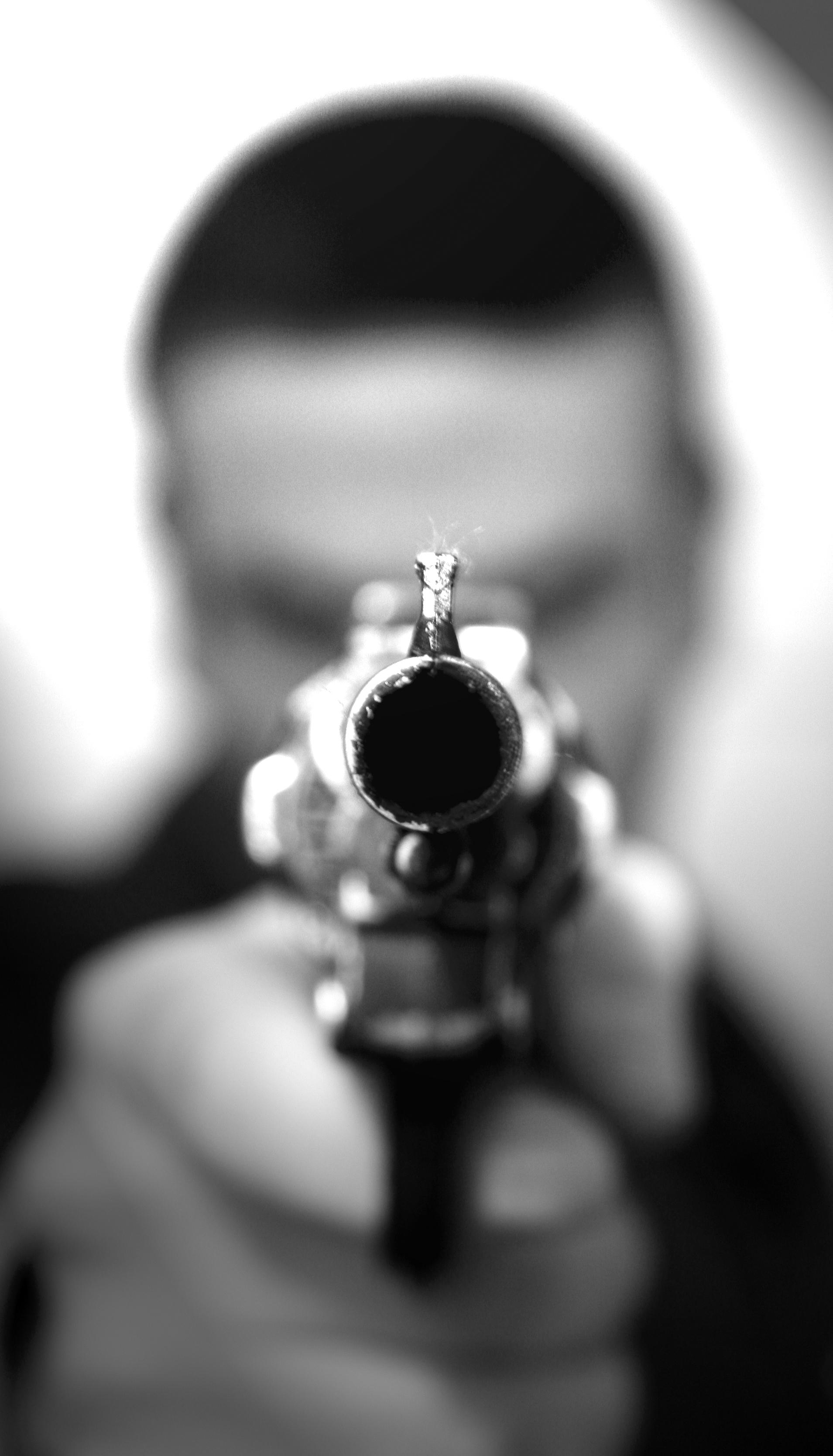 Straight down the barrel of a gun Playing Dead Murder Mystery.jpg