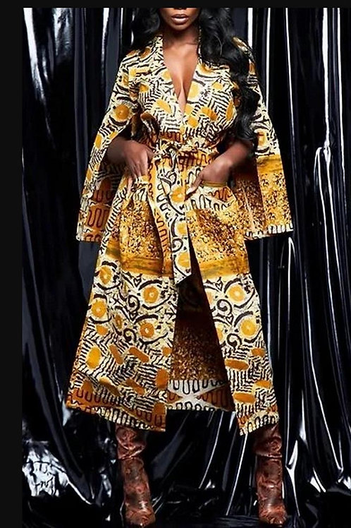Gold/Black African Print Duster And Fits Up To A Large Comfortably