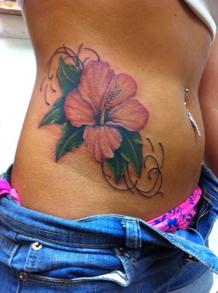 Rib flower tattoo