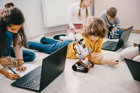 little-kids-programming-with-laptops-whi