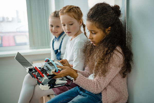 group-of-little-schoolgirls-working-with-laptop-to-2021-06-15-02-06-23-utc-min.jpg