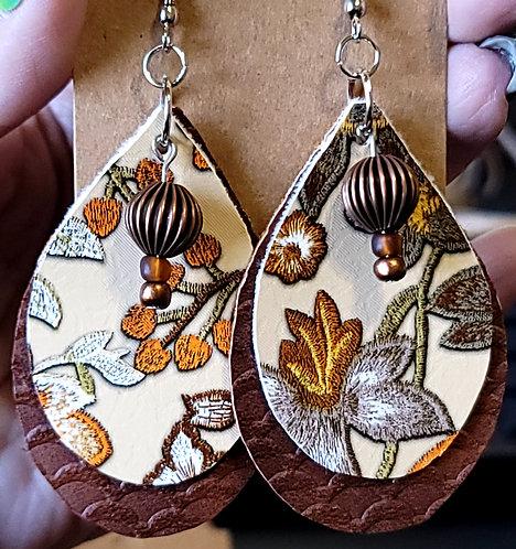 Fall Floral Teardrop Earrings on Brown