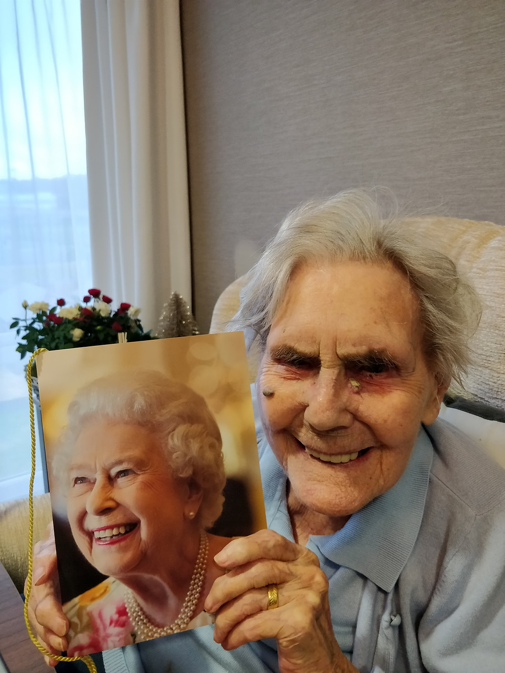 Celebrating 100 year birthday with card from the Queen