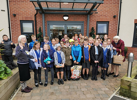 Residents at Lostock Lodge Care Home enjoy visit from Bexton Primary School