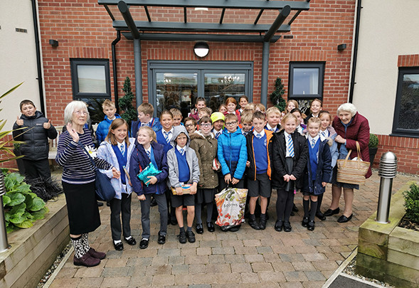 Pupils from Bexton Primary School received a warm welcome at Lostock Lodge Care Home
