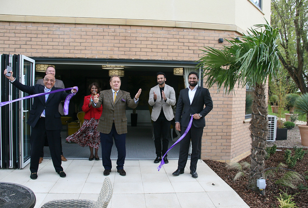 Fenchurch House Care Home - Pictured at the ribbon cutting from left:     Front: Abdul Kachra – Chairman Country Court  Back: David Hicks – Estates Director Country Court  Back: Suria Webb – Home Manager Fenchurch House  Front: Sir John Hayes MP  Back: Alykhan Kachra – Co-CEO Country Court  Front: Al-Karim Kachra – Co-CEO Country Court