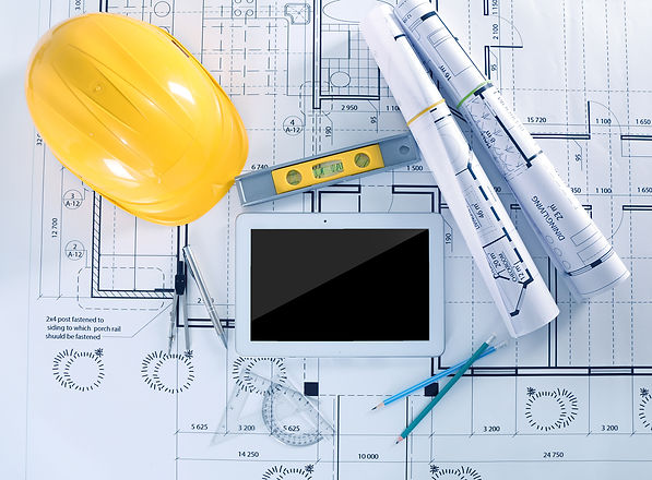 Construction blueprints with tools and t