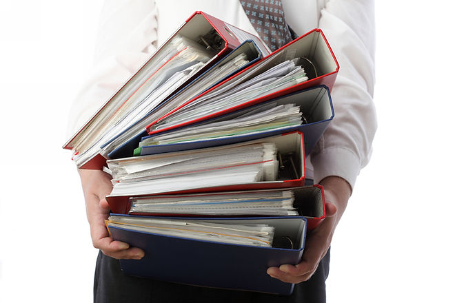 man holding stack of folders Pile with o