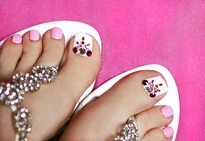 Pedicure on women's legs covered with wh
