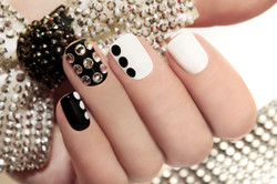 Manicure on short nails covered with bla