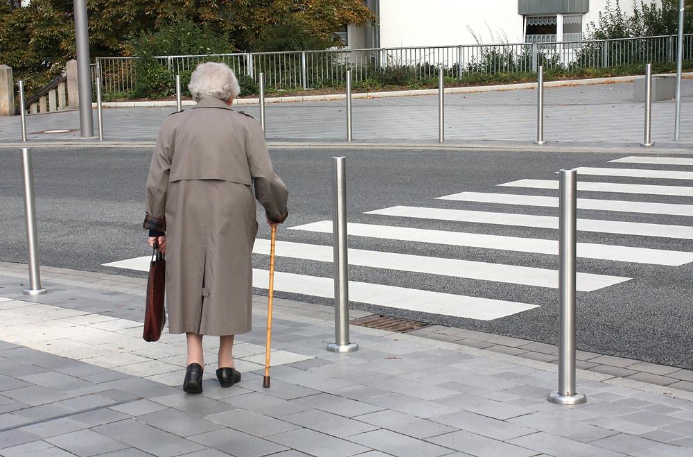 Elderly woman crossing the street