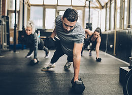 Workout Class Training With Weights On Floor