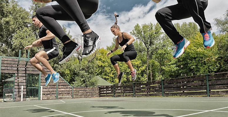 Outside Workout Class Jumping Together