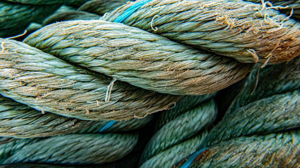 Closeup of frayed rope symbolizing the hard work that must be done for males.