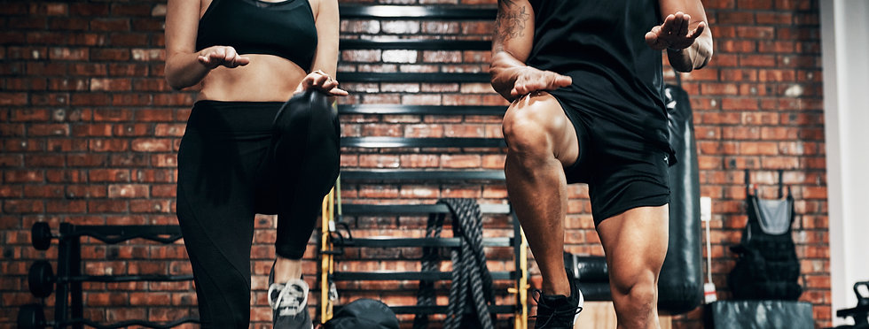 Man And Woman Doing High Knee Step Workout In Gym