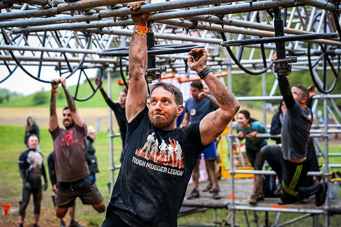 Tough Mudder Course Participant Scaling Monkey Bars