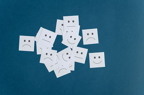 many-white-post-it-papers-with-smiling-s