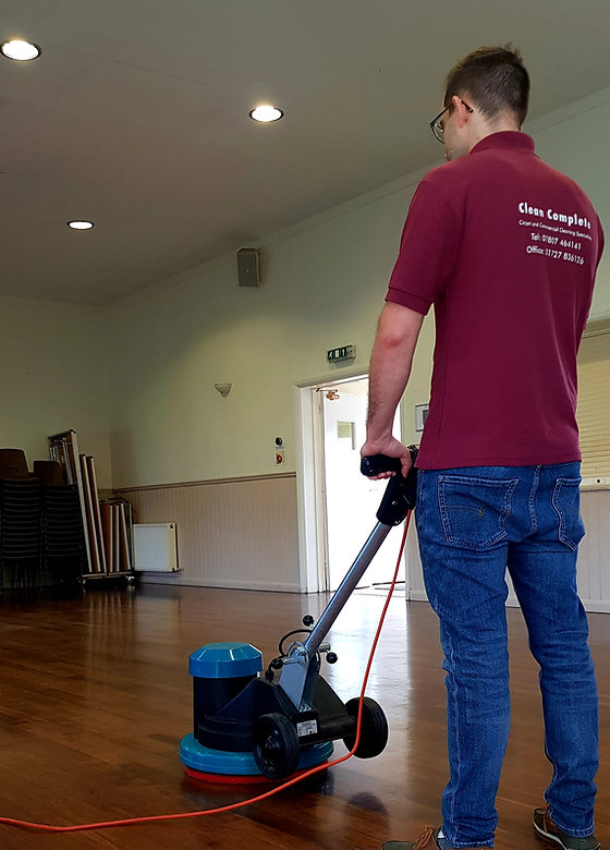 Cleaner using Truvox machine to polish wooden floors