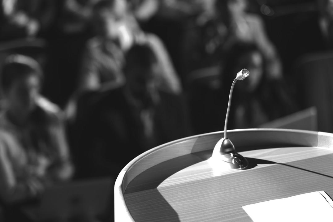 close-up-of-podium-with-speaker-in-audit