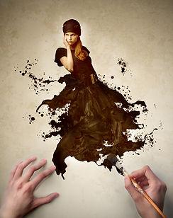 Man's hands painting the elegant dress o