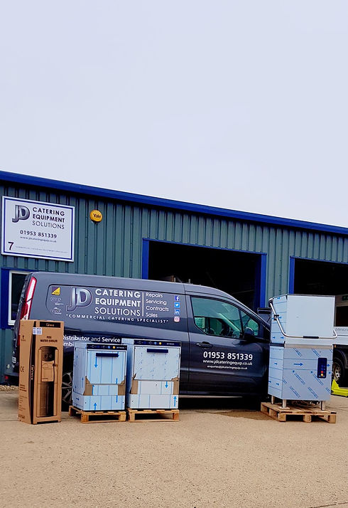 JD Caterings delivery van with appliances waiting to be loaded.