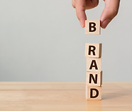 building blocks being stacked up to spell the word 'brand'