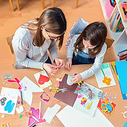 Crafting-Mom-and-Kids-at-Table-Making-Ki