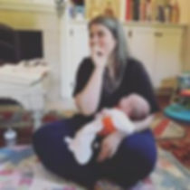 Doula Zoe Etkin leading a mom support group holding baby Memphis