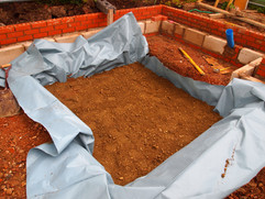 Preparation for concrete pad and shutter wall