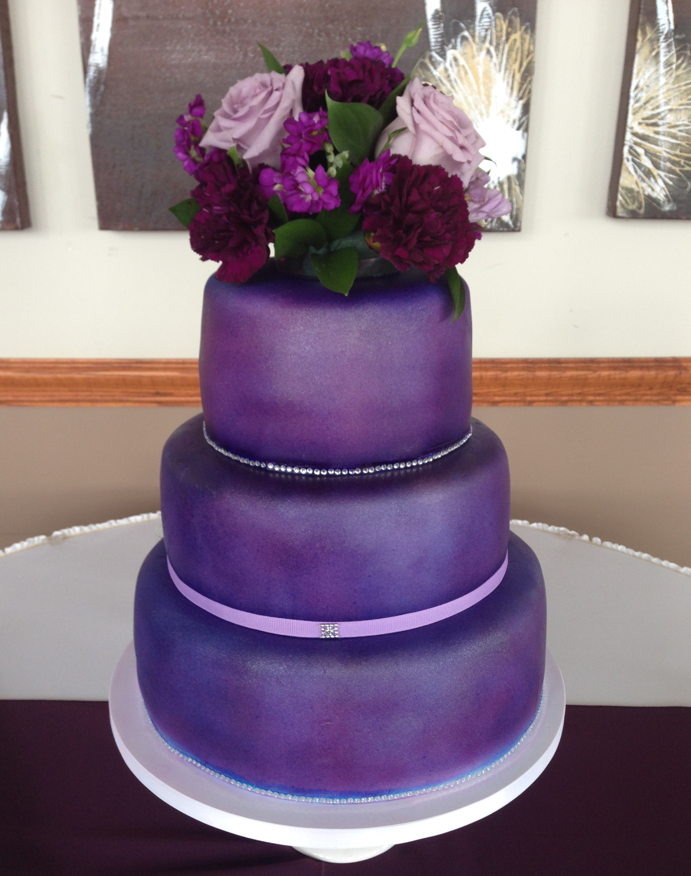 Tiered purple wedding cake w/ floral