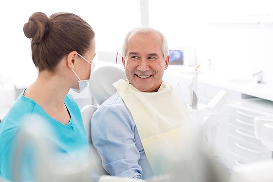 bigstock-Female-dentist-talking-to-smil-