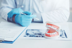 bigstock-Dentist-With-Denture-Learning--