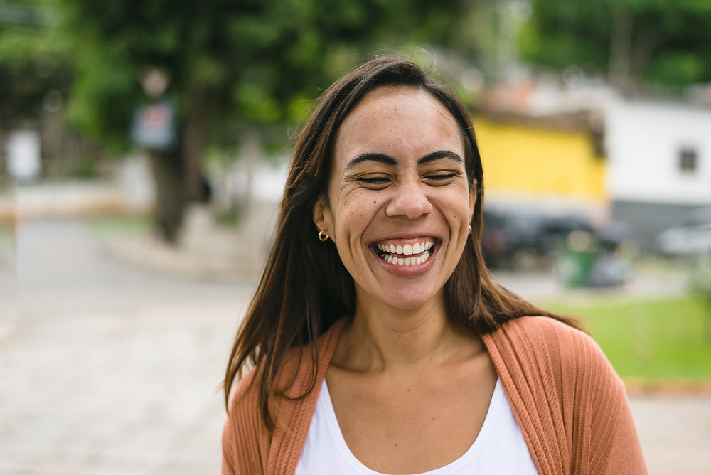 Woman smiling because her life is in rhythm