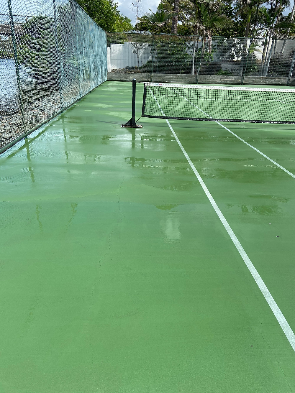 here is the after photo from our tennis court pressure cleaning we complete at sailfish cove on the gold coast. Beautiful spot right on the canal in mermaid waters.