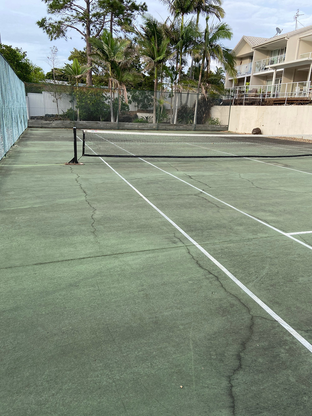 This is a picture we took at sailfish cove in mermaid waters on the gold coast old. This is the photo of there tennis court before we cleaned in using our high pressure cleaner.