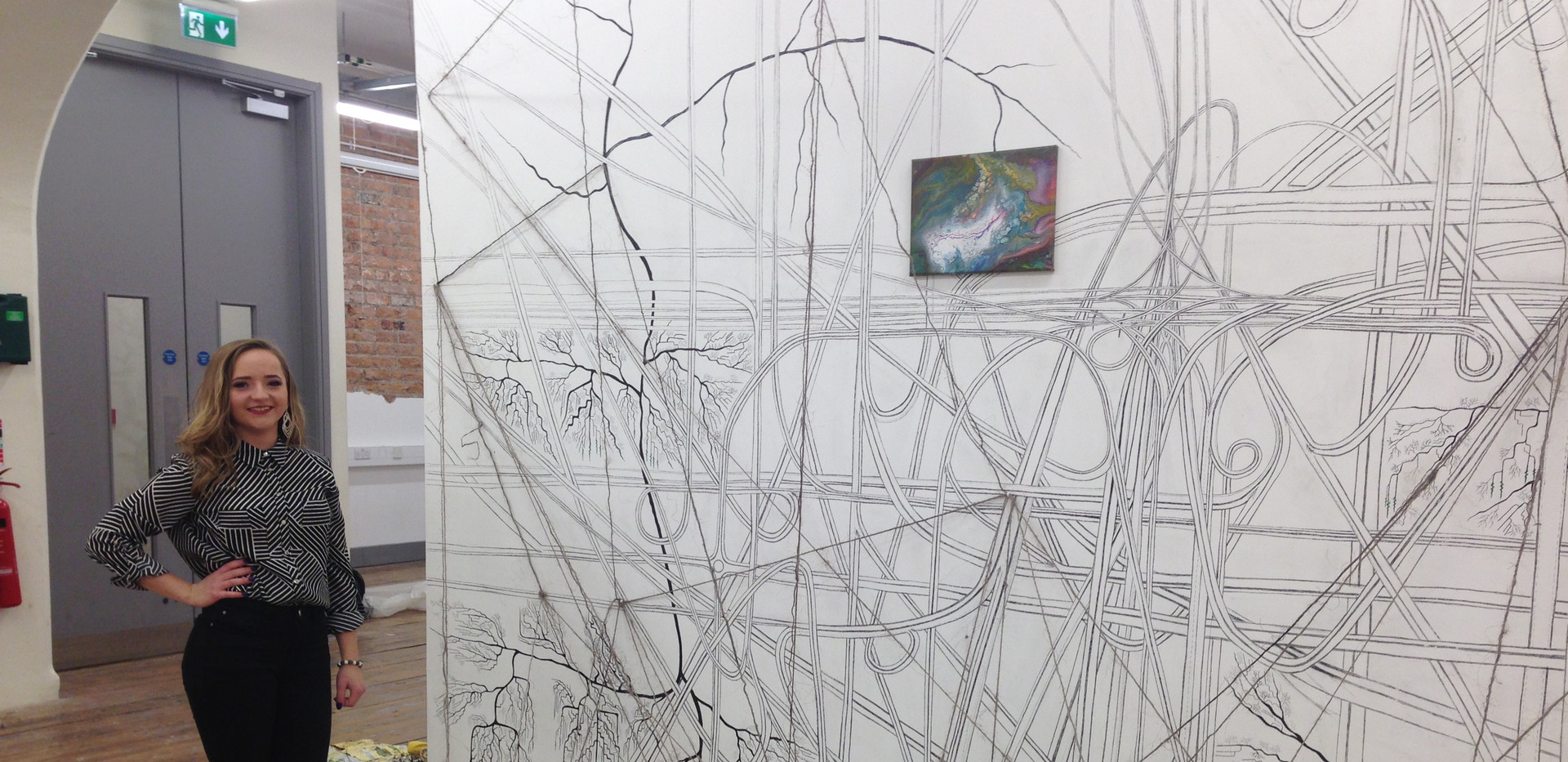 an Artist and side View of an Installation, Complex Systems