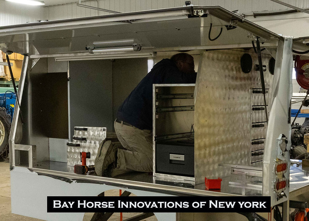 Fitting the components of a custom truck body at Bay Horse Innovations of New York.
