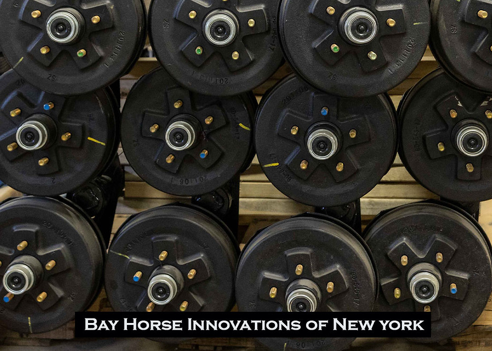 Stack of axles for future custom vet and farrier trailers at Bay Horse Innovations New York