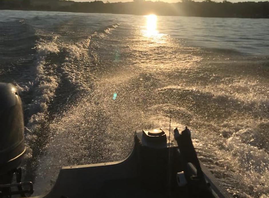Wilderness Medical Instructor Alice Henshaw fishing Cayuga Lake