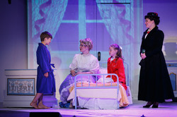 Dana as Mrs Banks, with Mary Poppins and kids
