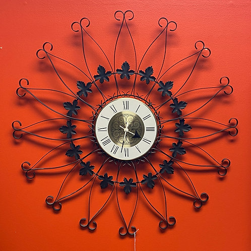 Black Metal Mediterranean Starburst Clock