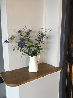 flowers on shelf