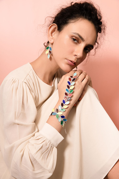 Meena multicoloured earrings and bracelet shot with a model