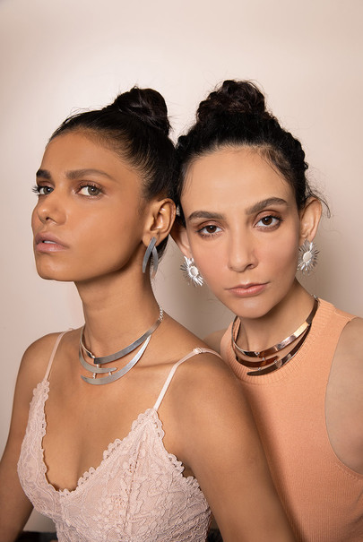 crescent shaped neckpieces in sterling silver shot with two models