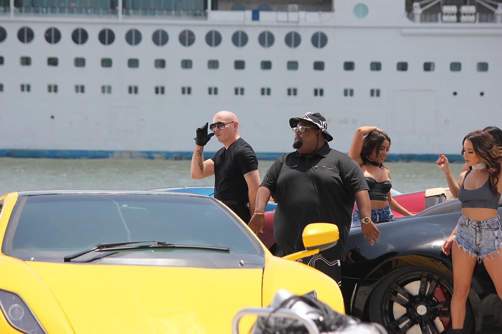 Veluxity Exotic Car Rental On Set With Pitbull