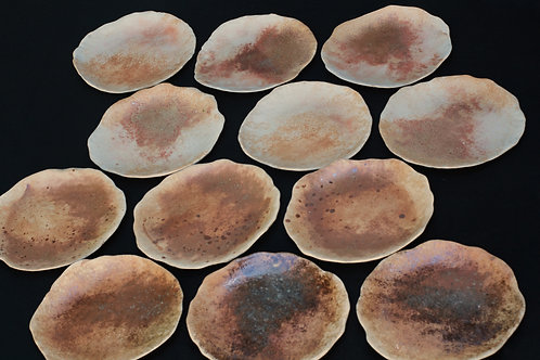 Set of four stoneware plates: brown earth