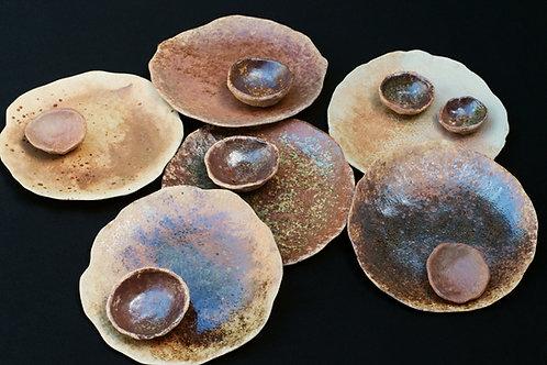 set of four stoneware plates: mixed earth