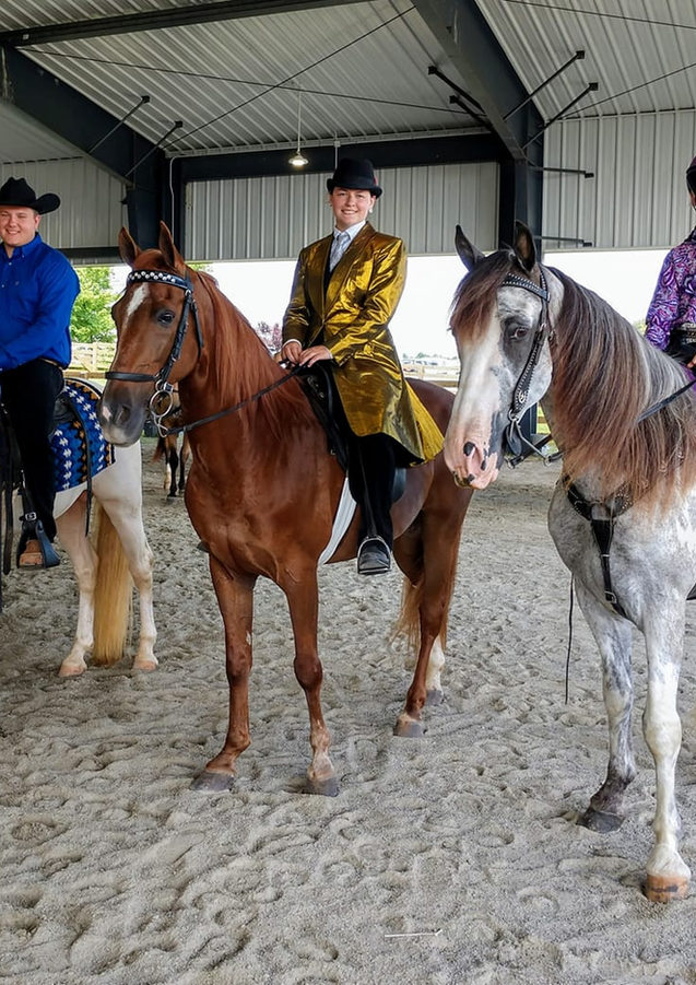 Three riders warm up arena.jpg